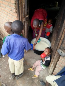 Malaye giving out Maize gruel at break.